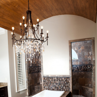 Rounded Ceiling with Chandelier in Master Bathroom